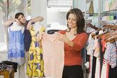 Hispanic couple shopping in clothing store — Stock Photo