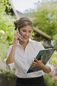 Hispanic businesswoman talking on cell phone — Stock Photo