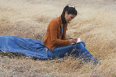 Asian woman writing in journal — ストック写真