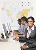 Indian businesspeople wearing headsets — Stock Photo