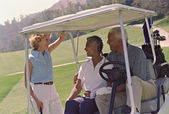 Multi-ethnic seniors on golf course — Stock Photo