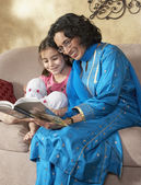 Indian grandmother reading to granddaughter — Stock Photo