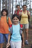 Hispanic family hiking in woods — Stock Photo