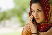 Middle Eastern woman talking on cell phone — Photo