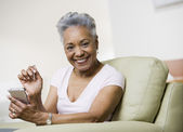 Senior African American woman holding electronic organizer — Stock Photo