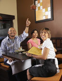 Multi-ethnic friends at restaurant — Stock Photo