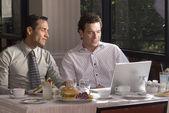 Hispanic businessmen at restaurant — Stock Photo