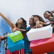 Hispanic friends holding shopping bags — Stock Photo #23313364