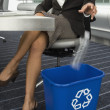 Hispanic businesswoman recycling bottle — Stock Photo
