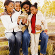 African family looking at digital camera — Stock Photo