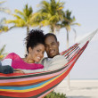 Hispanic couple laying in hammock — Stock Photo