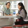 Asian waitress giving bill to customer — Stock Photo