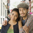 Multi-ethnic couple hugging in urban scene — Stock Photo
