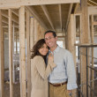 Hispanic couple at new construction site — Stock Photo