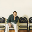 Mixed Race man sitting in waiting area — Stock Photo