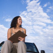 Mixed Race woman on truck holding clipboard — Stock Photo