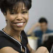 Close up of African businesswoman smiling — Stock Photo #23313806
