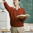 Asian male teacher calling on student — Stockfoto