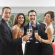 Multi-ethnic couples toasting with champagne — Stock Photo