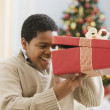 African boy peeking into gift — Stock Photo