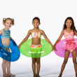 Multi-ethnic girls wearing bathing suits — Stock Photo