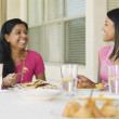 Indian family eating on patio — Stock Photo