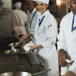 Multi-ethnic chefs preparing food — Stock Photo