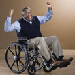 African man cheering in wheelchair — Stok fotoğraf