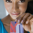 Hispanic woman holding credit card — Stock Photo