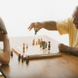 Multi-ethnic senior men playing chess — Stock Photo