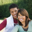 Multi-ethnic couple hugging — Stock Photo