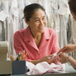 Stock Photo: Asifemale dry cleaner and customer looking at stain