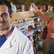 Pacific Islander pharmacist in front of customer — Stock Photo