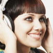 Mixed Race woman listening to headphones — Stok fotoğraf