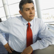 Hispanic businessman leaning on table — Stock Photo