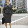 Asian businesswoman in urban area — Stock Photo