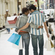 Multi-ethnic couple carrying shopping bags — Foto de Stock