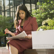 Indian businesswoman reading newspaper — Stock Photo