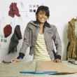 Indian female fashion designer in workshop — Stock Photo #23314920