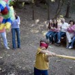 Hispanic boy swinging at pinata — Stock Photo #23314960