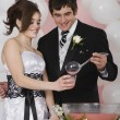 Stock Photo: Hispanic mpouring punch for girlfriend at prom