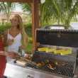 Multi-ethnic couple barbecuing — Stock Photo #23314992