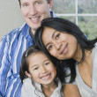 Stock Photo: Mixed Race family hugging