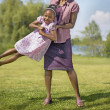 African mother playing with daughter — Stock Photo