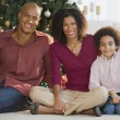 African family in front of Christmas tree — Foto Stock