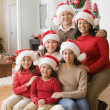 Hispanic family wearing Santa Claus hats — Stock Photo