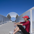 Hispanic woman in running gear leaning against railing — Stock Photo #23315348