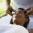 Hispanic woman receiving facial massage — Stock Photo