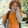 Mixed Race boy talking on cell phone — Stock Photo #23315482