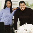 Multi-ethnic architects next to house model — Stock Photo